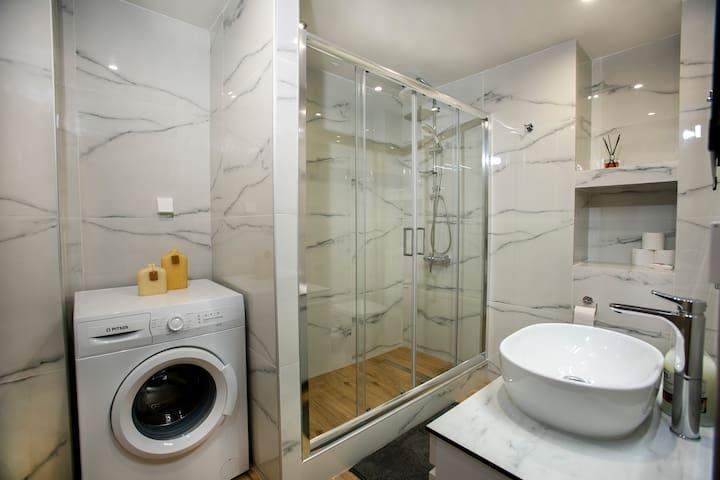 Spacious bathroom with a big shower