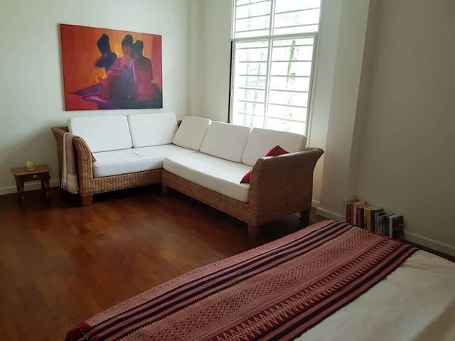 Cosy, bright house filled with Burmese art