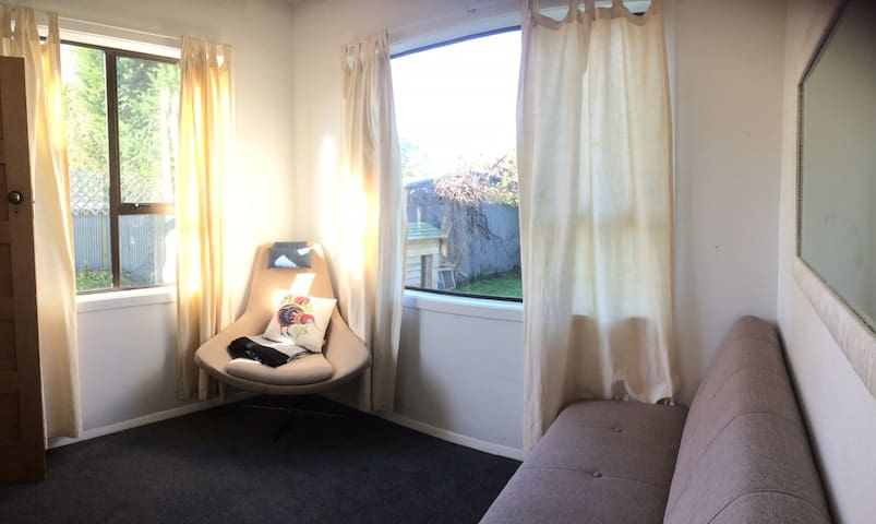 Sunny guest room with views to garden/outdoor area