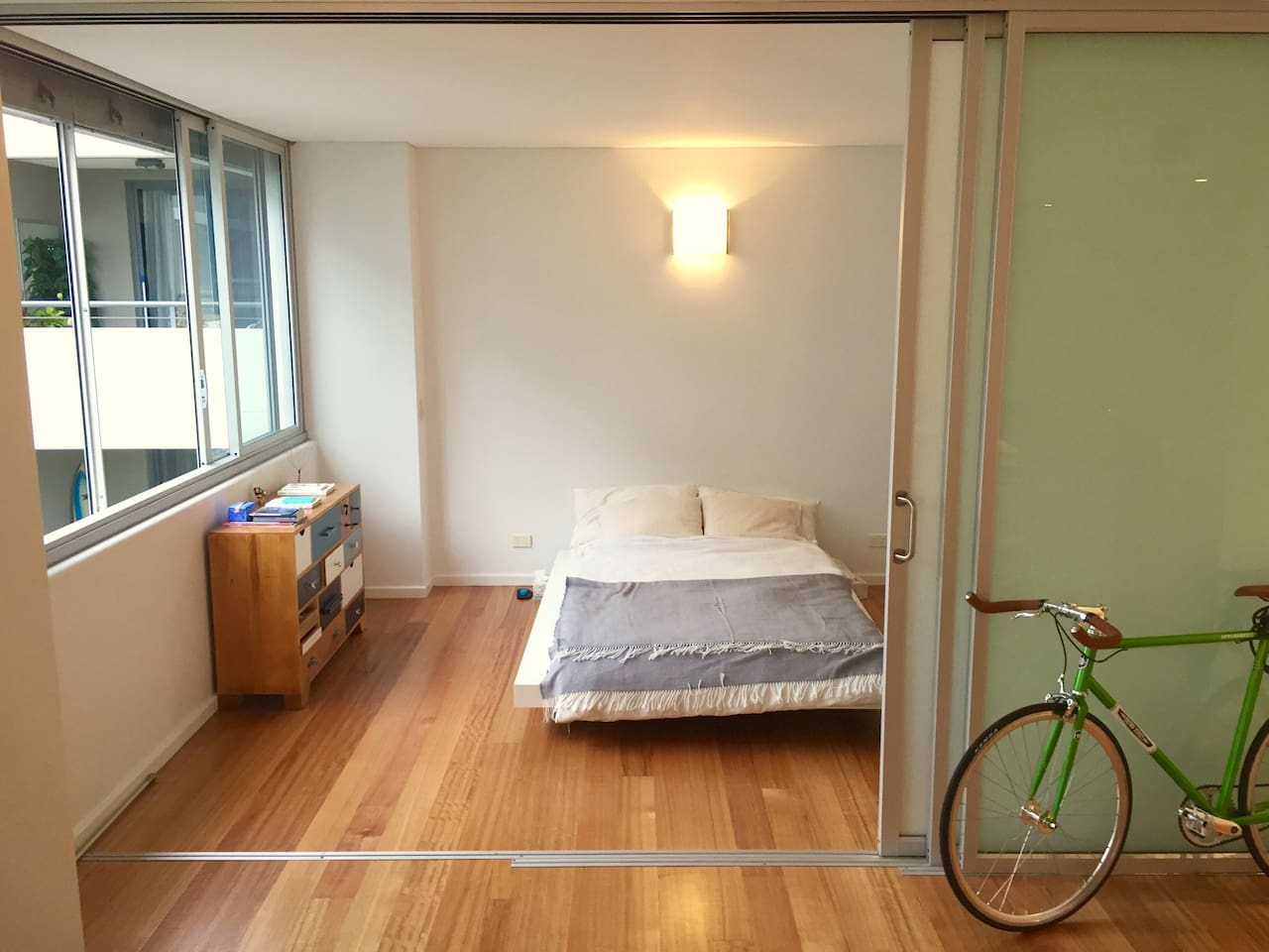 Our bedroom is spacious, light-flooded, has a huge built-in wardrobe and is separated to the rest of the apartment by a sliding door. The big windows go out into the courtyard which allows for quite nights and good sleeps