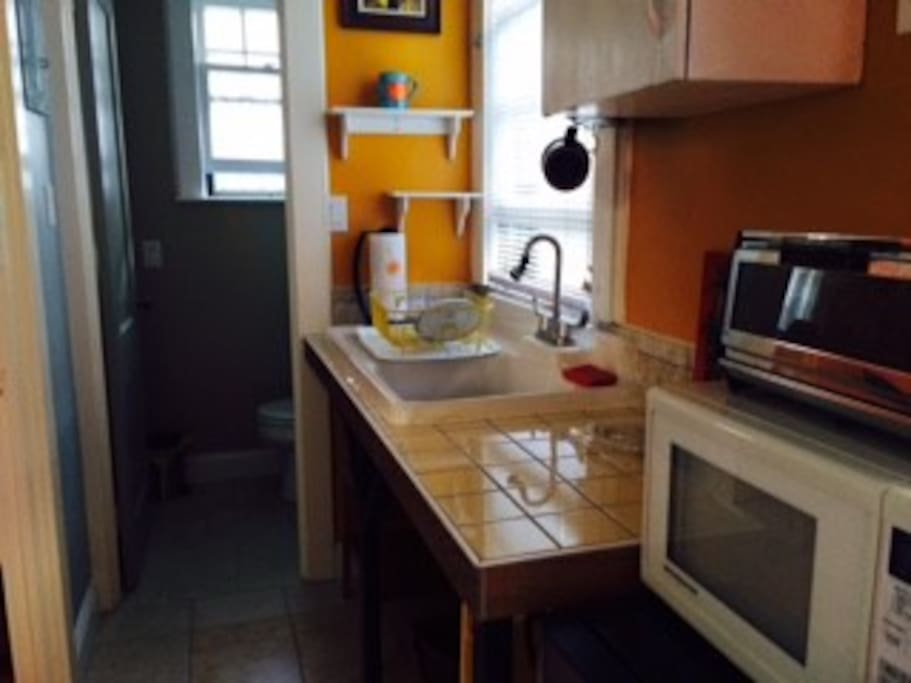 Kitchen with bathroom in back