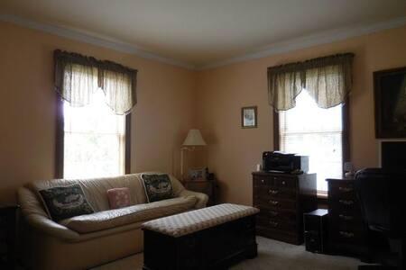 Bright, peaceful quiet corner room with sofa!