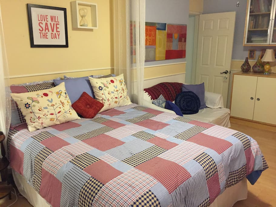 Comfy, queen size bed and loveseat in the room give guests spaces to curl up in!