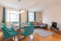 Living and Dinning Room fully furnished with comfortable chairs and couch