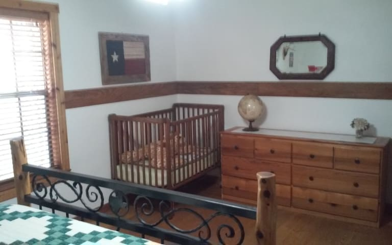 Baby crib in downstairs bedroom
