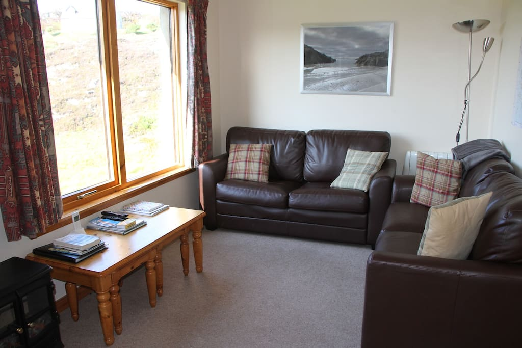 Comfy lounge area - a great place to kick back, relax and enjoy those views!