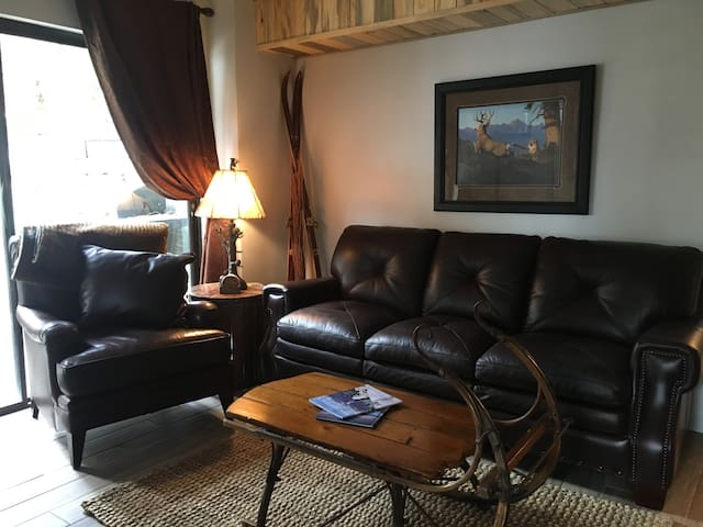 beautiful leather sofa and chair with antique sleigh coffee table