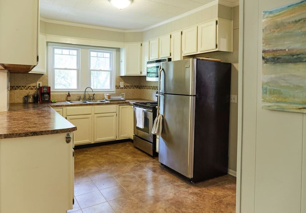 Full equipped kitchen with microwave and coffee pot.