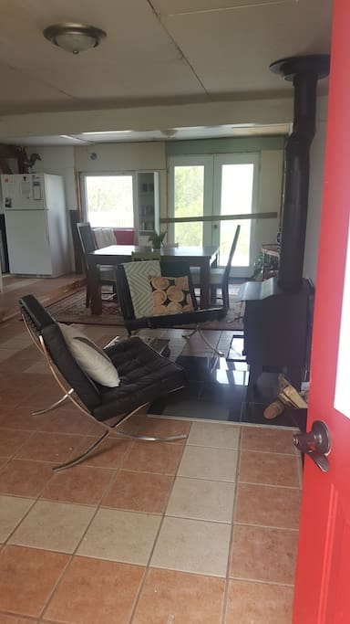 Upon entry experience cottage life at its best with wood burning stove, Barcelona chairs and large dining room.
