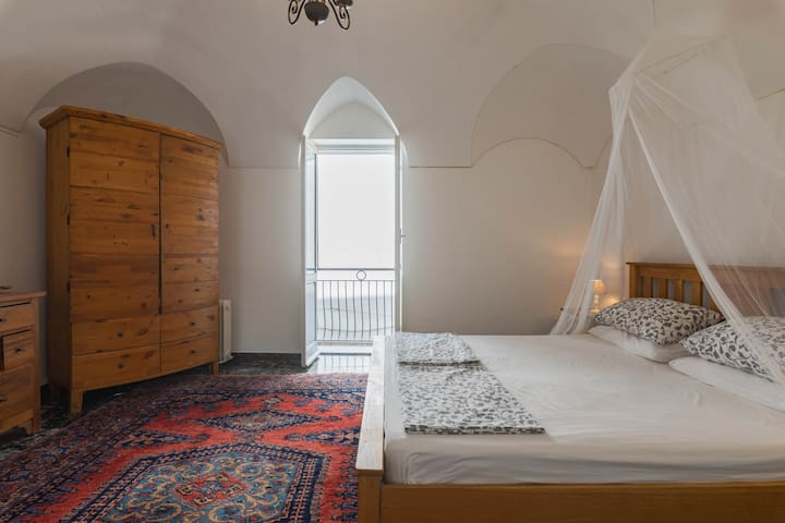 Persian rug, and antique wardrobe provide plenty of comfort and storage