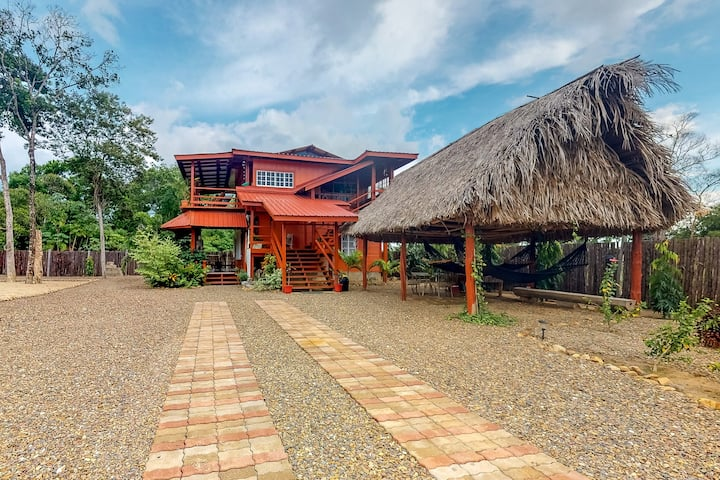 Wooden home w/ hammocks, BBQ area, enclosed yard, WiFi & AC - near town/beach!
