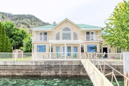 Sunny, lakefront home with huge patio, floating dock & 2 buoys