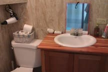 Clean and tiled private bathroom.