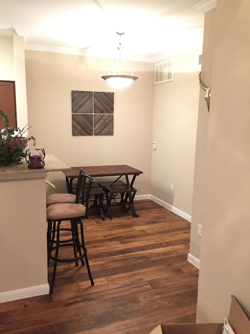 Kitchen eating area. Table with four stools