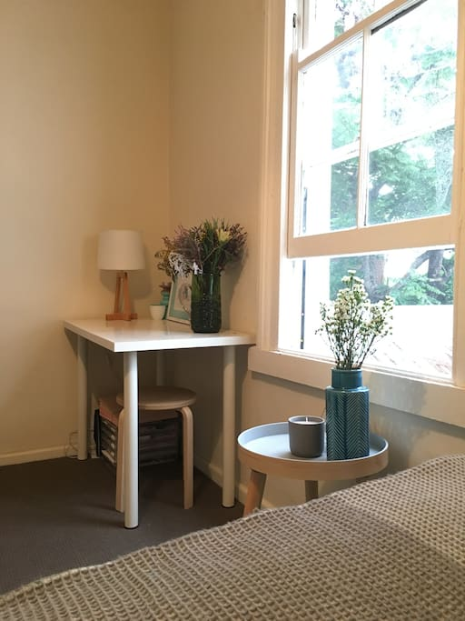 Light and bright room with a desk and chair
