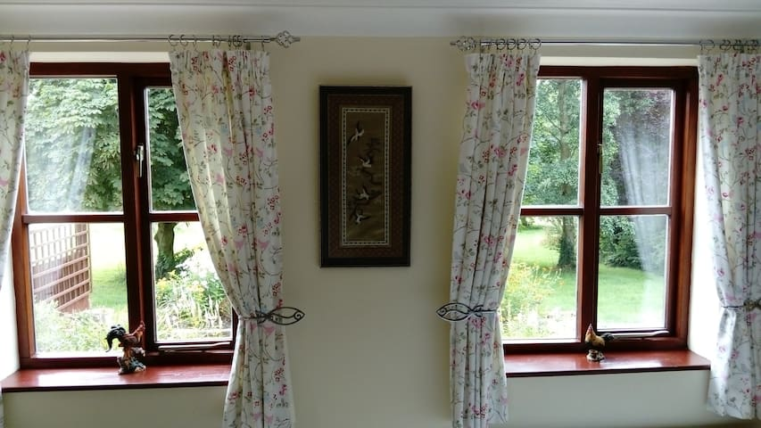 View from bedroom to garden and meadow.