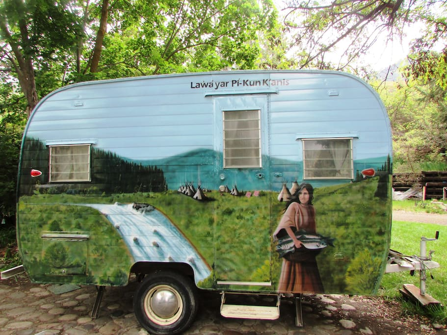 Hand-painted mural over entire camper.