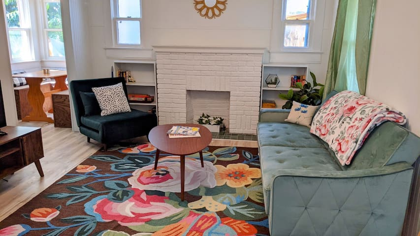 Charming living room with 3 sofa bed options (2 single, one double).