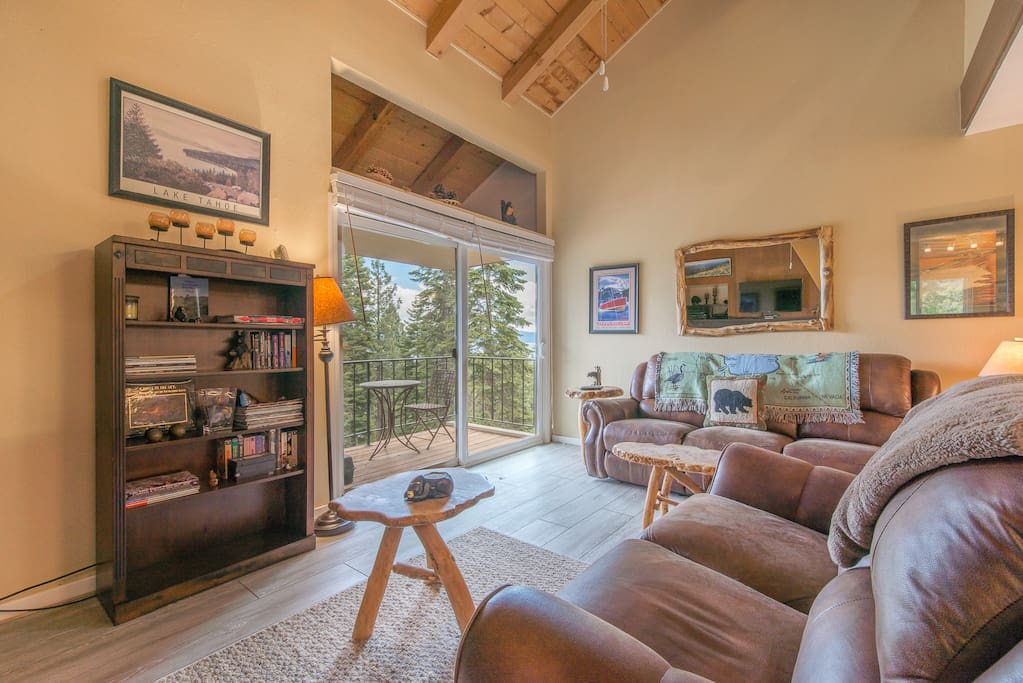 Light open bright family room with vaulted ceilings and wood burning fireplace!