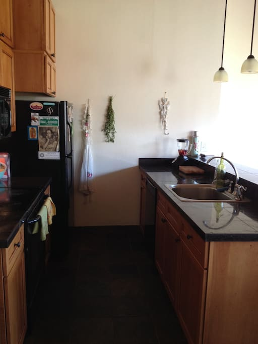 Open Kitchen with Granite Counter Tops and Full Amenities