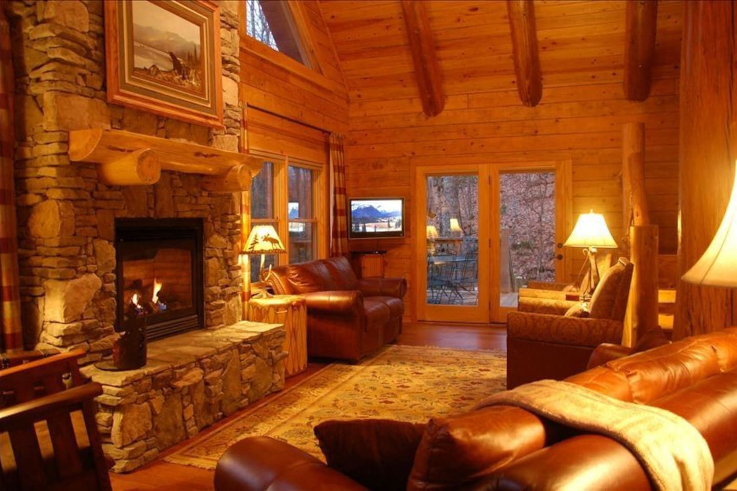 The Great Room with 24-foot, vaulted ceilings, log beams and stone fireplace.