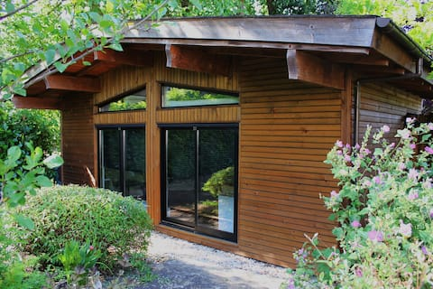 Independent chalet at the back of a garden.