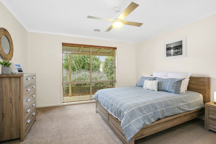 A spacious Master bedroom is located at the front of the house, with a lavender garden aspect, a walk-in robe and en suite (shower, vanity, toilet).