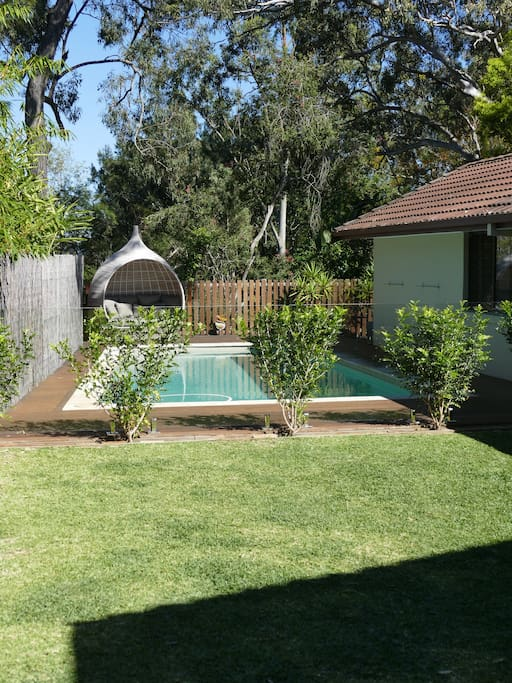 Garden area adjacent to the pool, great for kids!