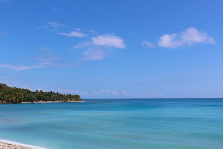 Haiti's south coast... white sands - swim, surf and sunbathe just down the hill.