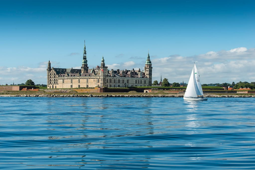 Kronborg Castle towers above a very narrow promontory between the coasts of Denmark and Sweden.