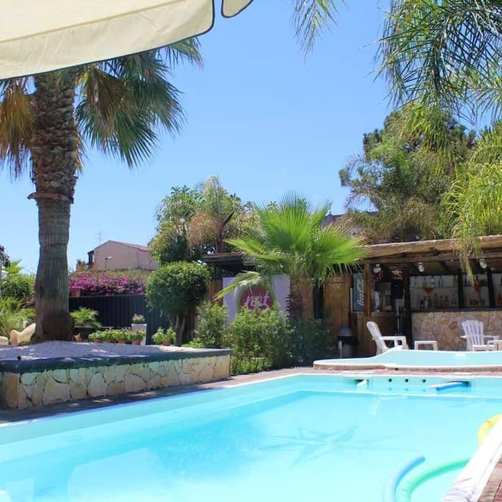 Apartment with one bedroom in Vaccarizzo-delfino, with shared pool, balcony and WiFi - 50 m from the beach