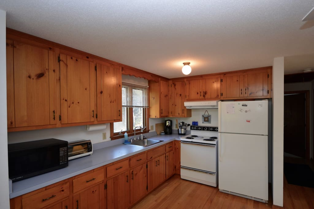 Kitchen includes full size fridge, stove and microwave. Cooking equipment and coffee maker.