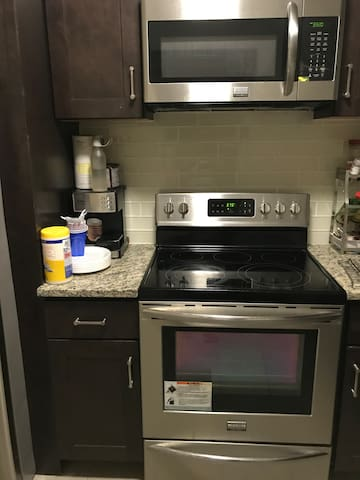microwave, electric stove and oven