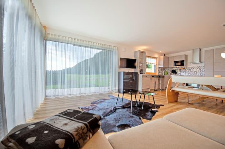 144 - Moderno appartamento con giardino