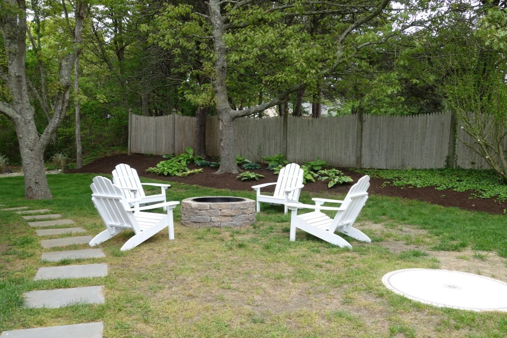 The fire pit and the Adirondack chairs in the back yard are guest favorites.