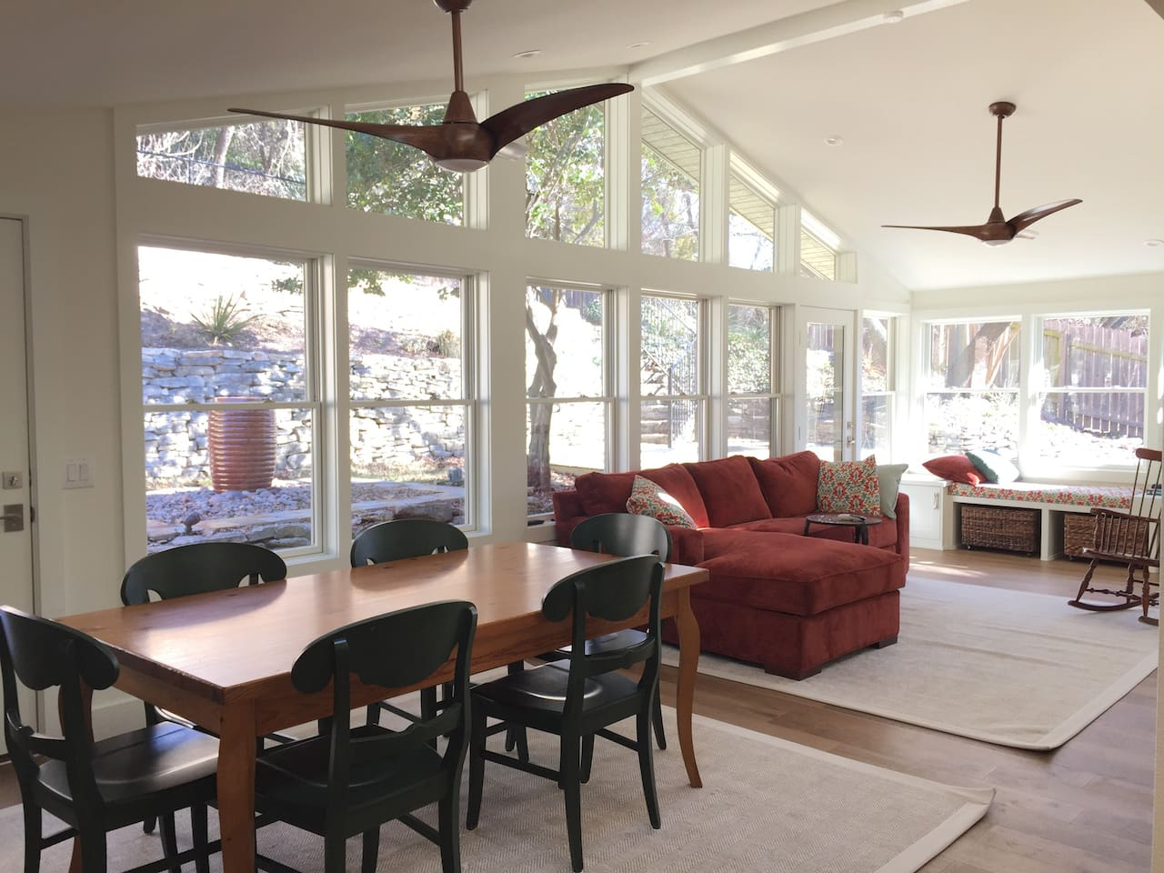 The sunroom, with wall to wall windows, is a lovely place to sip coffee while watching the birds on the feeder outsider.