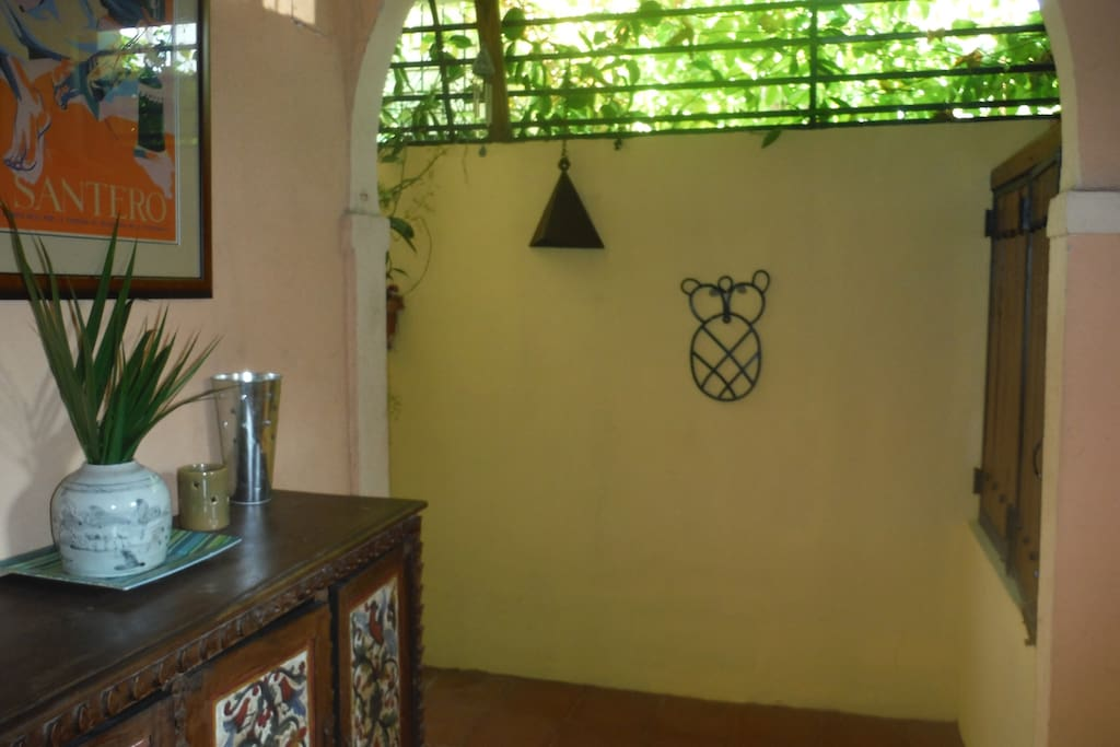 From the lobby, follow the Taino petroglyph and garden passage to your casita.