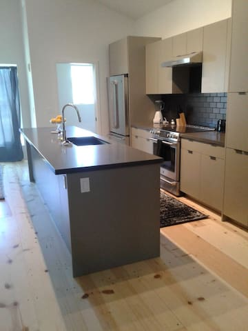 This brand new kitchen has utensils, baking pans, dishes, glasses, knives, forks, spoons, refrigerator, dishwasher and sink. We also supply a blender, coffee maker with Pegasus coffee (local) and tea. Salt, pepper, sugar, flour and cooking oil.