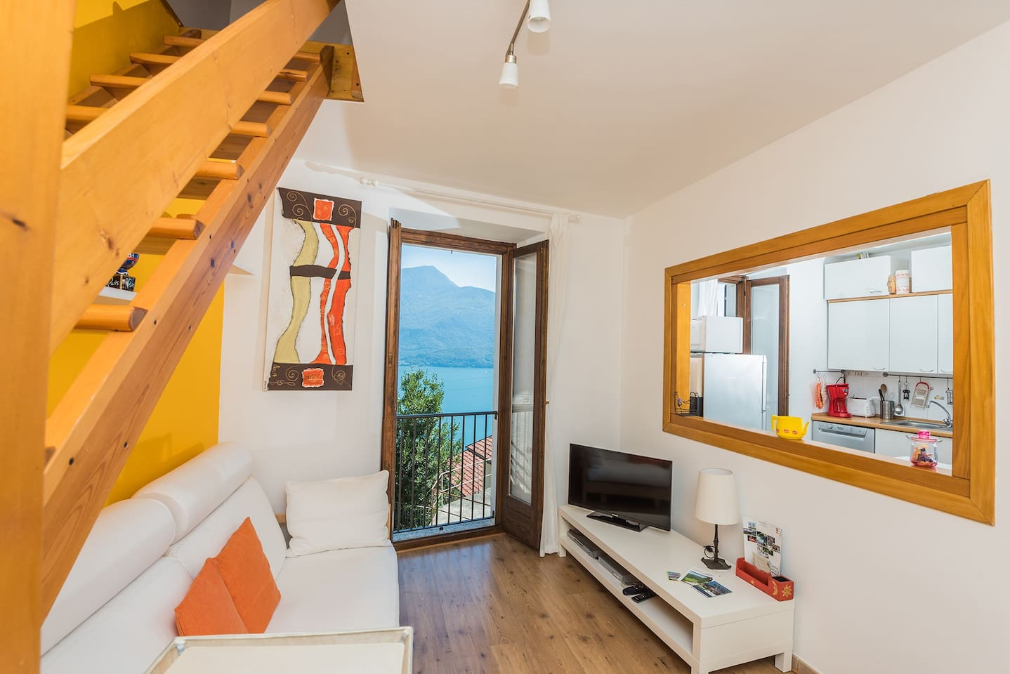 The bright living room with superb view over Lake Como