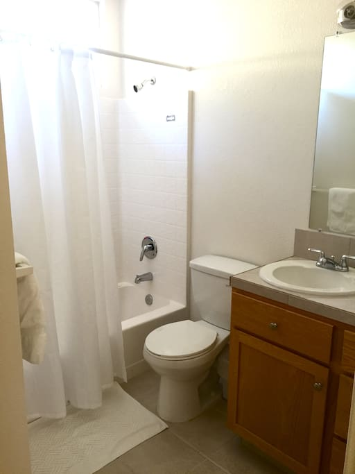 Bathroom with complimentary bath products and a shower/ tub combo.
