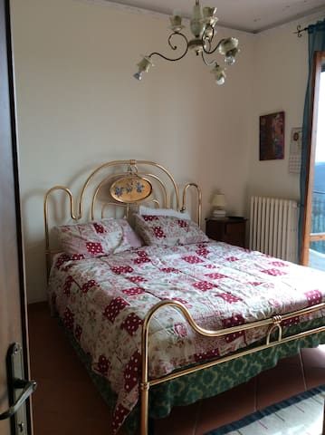 Bedroom (TV and balcony with views of chianti vineyars)