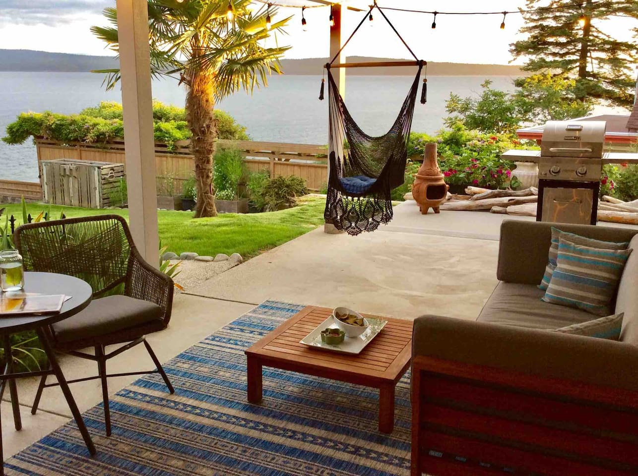 Private patio with BBQ and comfortable seating.