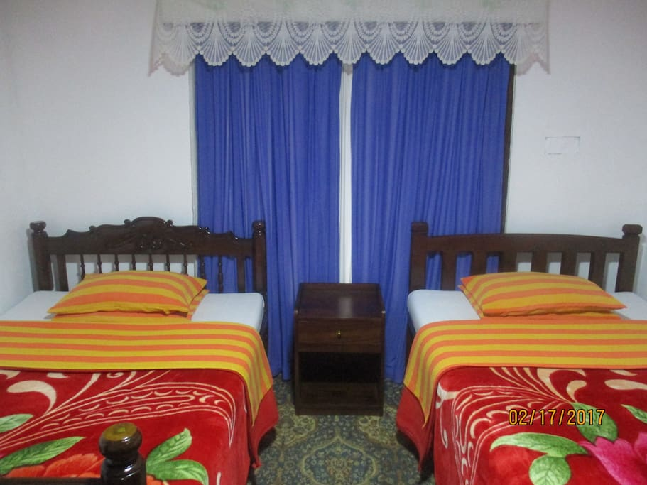 Room No. 1 with two double bed with a private tiled bathroom with hot water and shower.
