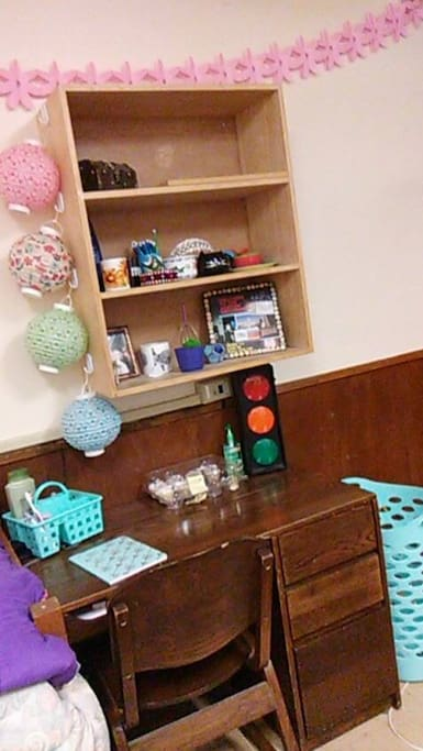 This is the desk space provided, as well as the shelving above it.