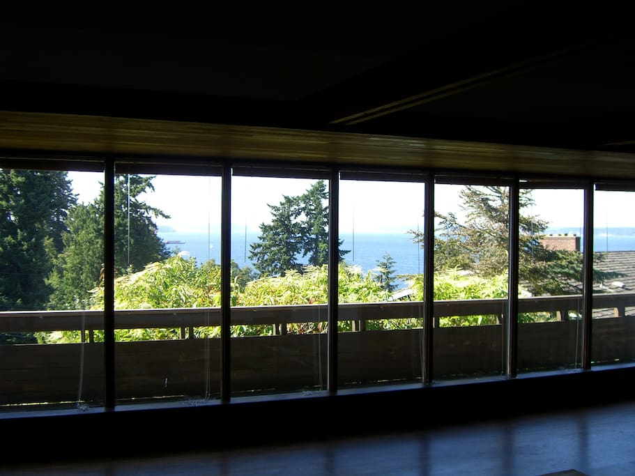 60 foot wall of windows overlooking park and Puget Sound.  This house is perfect for winter storms and heavy weather.  A gettaway.