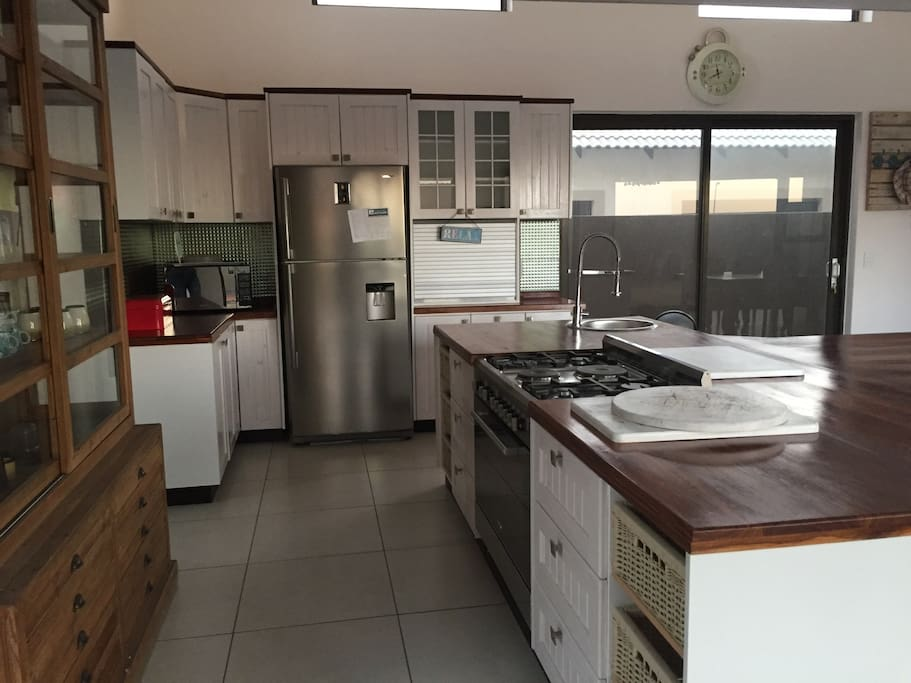 Open plan kitchen with fridge, microwave and gas/electrical stove. All kitchen utensils available to prepare hearty meals.