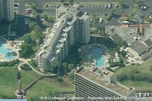 Aerial View of Building & Community Pools