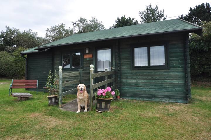 Chimes, Scandinavian-style wooden cabin.