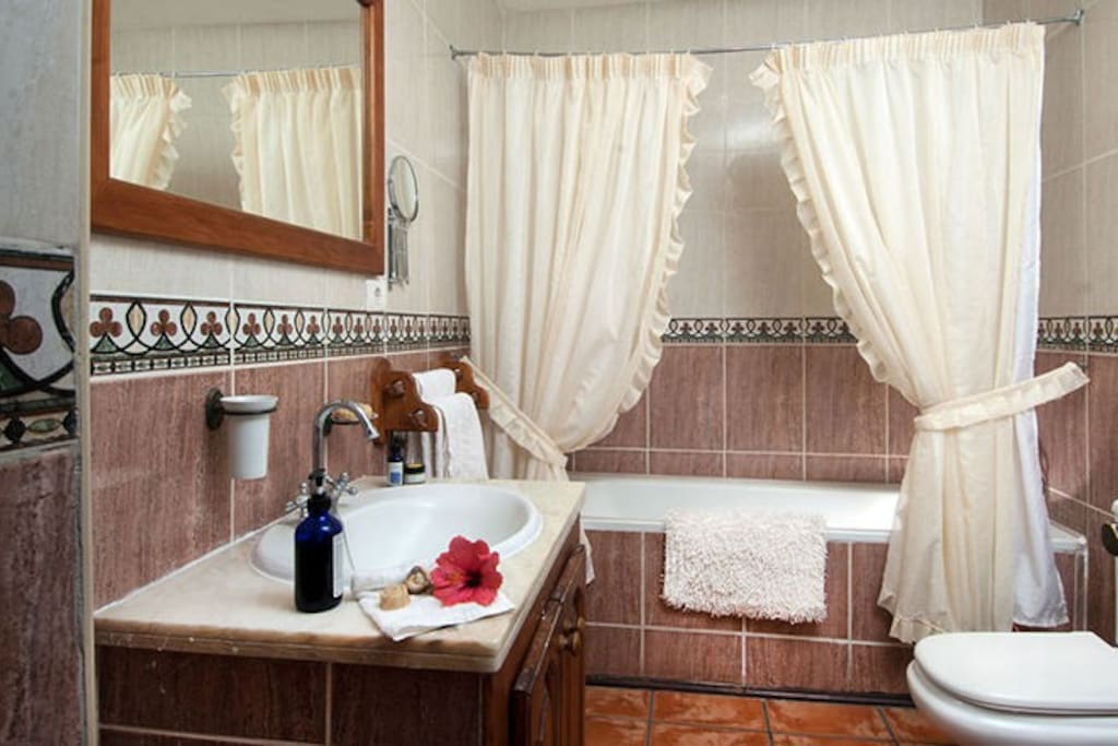 Bathroom with bath with shower