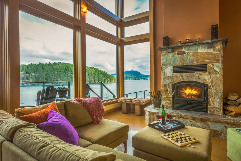 Warm wood burning fireplace with a spectacular waterfront view for cozy winter nights.